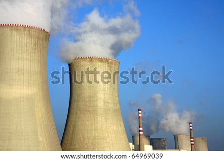 detail of nuclear power plant and cooling towers - stock photo