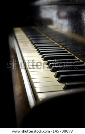Detail of old and dirty piano keyboard. - stock photo