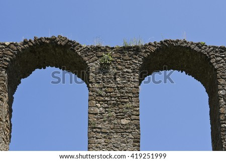 Detail of old aqueduct - stock photo