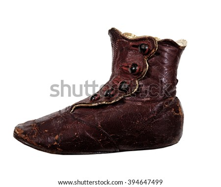 Detail of old Child's red leather shoe - stock photo