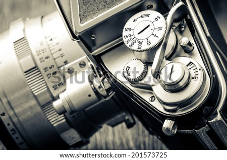 Detail of old classic camera mechanical dials in vintage monochrome style - stock photo