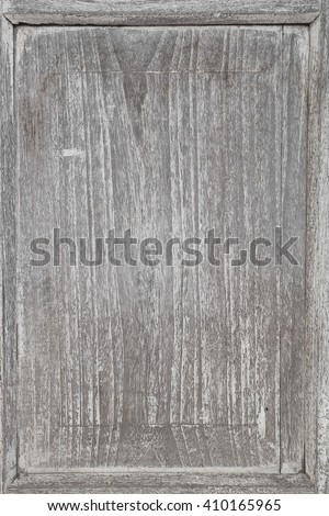 Detail of old gray wooden background of weathered distressed rustic wood with faded white paint showing woodgrain texture - stock photo