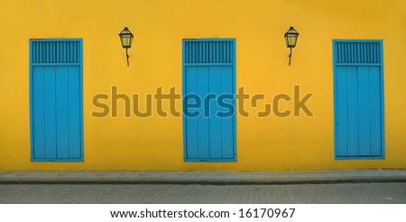 Detail of Old Havana building facade in yellow and blue - stock photo