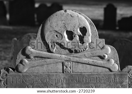 detail of old head stone in the granary burial ground in boston massachusetts dating back to 1660, here we see a skull with cross bones and an hourglass - stock photo