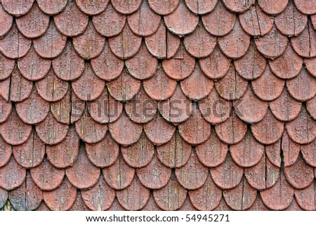 Detail of old house red roof tiles - stock photo