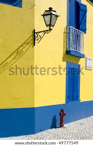 Detail of old houses facade in yellow and blue - stock photo