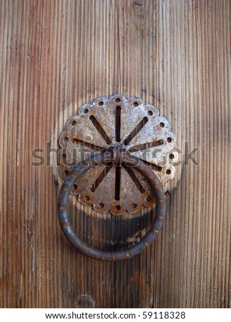 Detail of old knocker on the door - stock photo
