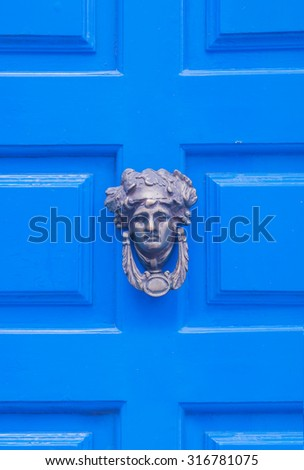 Detail of Old painted blue door . Background. - stock photo