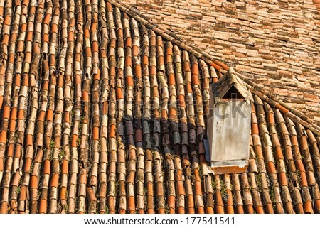 Detail of old roofing with chimney  - stock photo