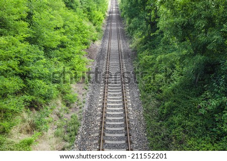 detail of old rusty track - stock photo