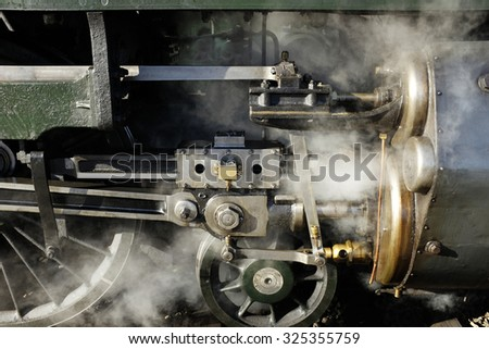 detail of old steam locomotive and wheels - stock photo