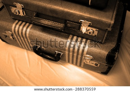 Detail of old suitcases symbolizing journey or embarking on a trip adventure - stock photo