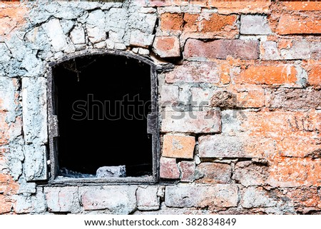 Detail of old weathered brick wall and window - stock photo