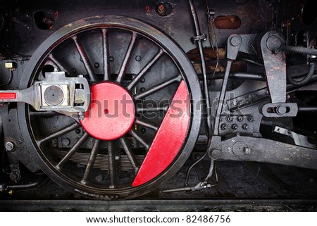 Detail of one wheel of a vintage steam train locomotive - stock photo