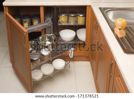 detail of open kitchen cabinet with cans of beans - stock photo
