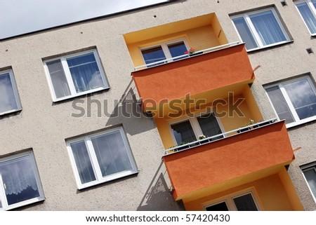 Detail of orange and yellow prefab house - stock photo