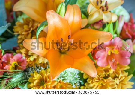 Detail of orange lilly  in  colorful bouquet.