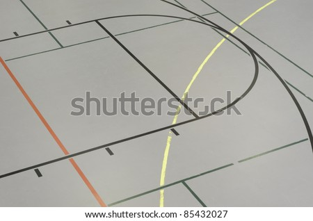 Detail of paint-lined intramural basketball court in college gymnasium - stock photo