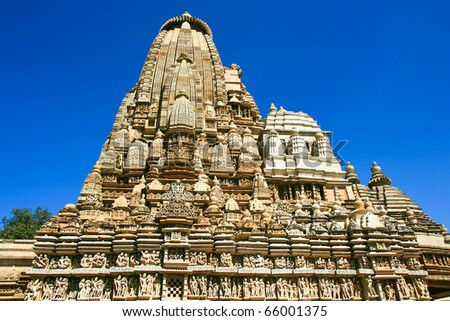 Detail of Parsvanath temple,  Eastern group of Temples with finest ancient art and sculpture in Khajuraho, Madhya Pradesh, India - stock photo
