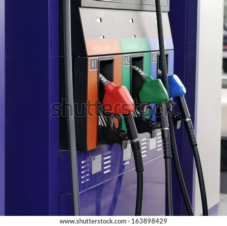 detail of petrol pump,blue green and red colors - stock photo