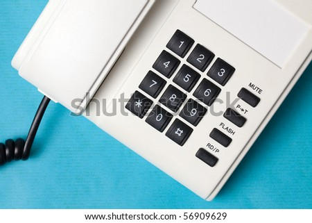 detail of phone on blue background - stock photo
