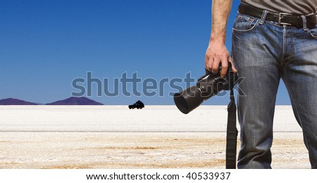 detail of photographer and desert landscape background - stock photo