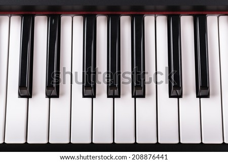 Detail of piano keyboard.