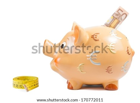 detail of piggy bank, measure tape and fifty euro banknote, concept for business and save money on white background - stock photo