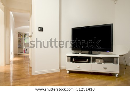 Detail of Plasma TV in a sleep room (bedroom) interior with open door to corridor - stock photo
