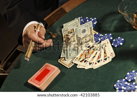 detail of poker game, money, card, cigar and chips on green table - stock photo