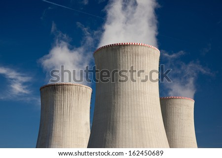 Detail of  power plant cooling towers - stock photo