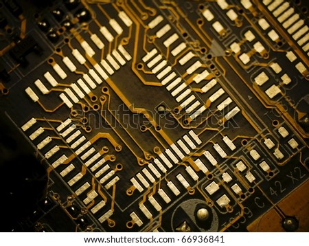Detail of printed circuit board, old motherboard - stock photo