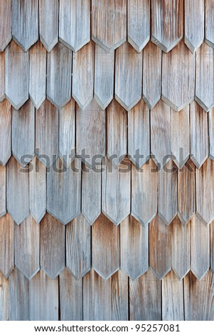 Detail of protective wooden shingle on the roof