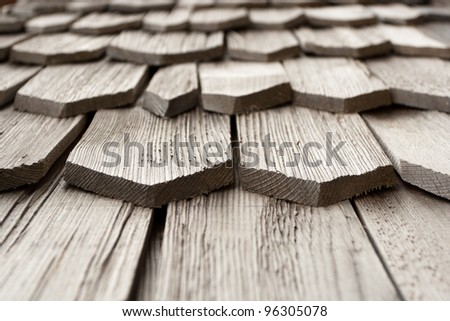 Detail of protective wooden shingle on the roof - stock photo