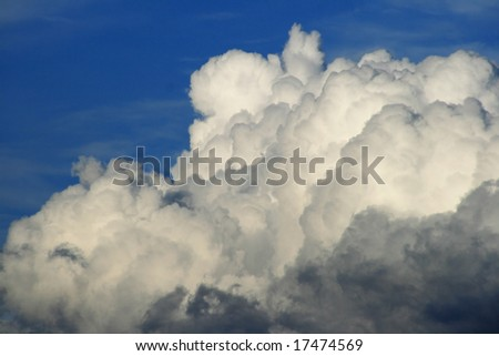 detail of puffy cloud against a blue sky - stock photo