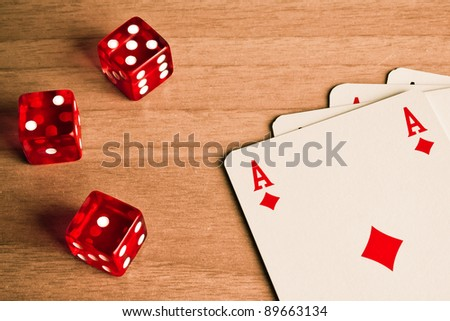 detail of red dice and cards on old wood - stock photo