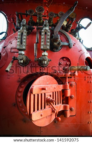 Detail of red engine room on the steam locomotive - stock photo