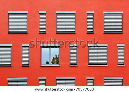 detail of red house wall with windows - stock photo