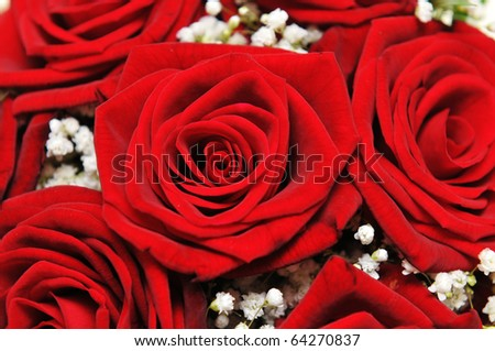 Detail of red roses on a bride's bouquet