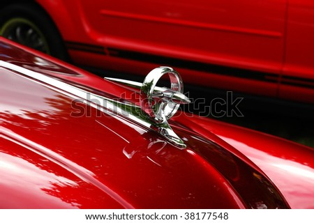 Detail of red shiny chrome plated antique car - stock photo