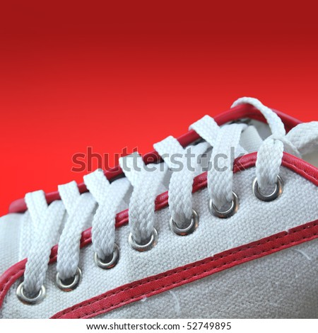detail of red sport shoes - stock photo