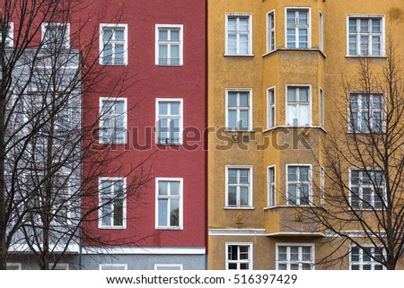 Detail of red yellow house wall with windows