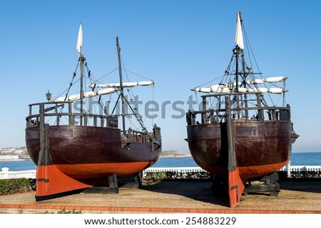 Detail of replicas of two caravels from the stern - stock photo
