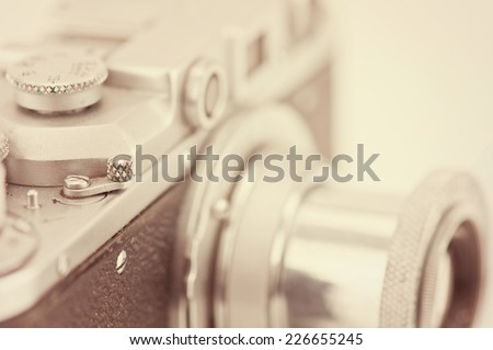 Detail of retro analog camera lens engravings isolated on white. - stock photo