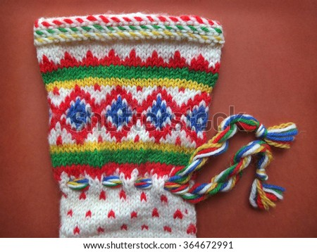 Detail Of Retro Winter Knitted Glove With Traditional Pattern - stock photo
