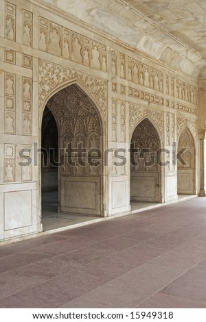 Detail of richly carved marble walls and arches decorating a Mughal Palace inside the Red Fort, Agra