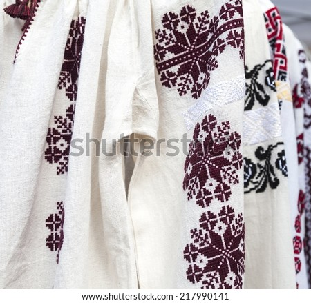 Detail of romanian traditional costumes - stock photo