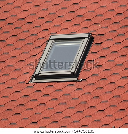 detail of roof window on top of the house - stock photo