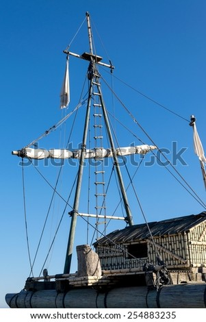 Detail of ropes, ladder and folded sails of replica of a raft - stock photo