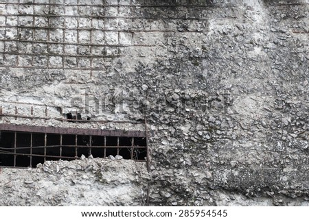 Detail of ruined concrete wall. Close up. - stock photo